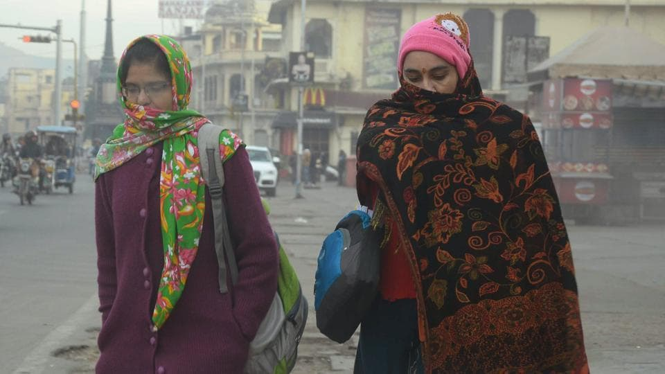 Women wrap themselves in layers of woollens as the mercury dips in Rajasthan.