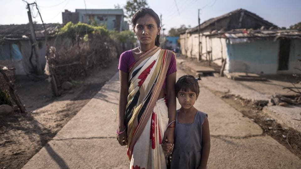 "Mangala Pawar, 28, here with her daughter, lost her husband Gajanan to a tigress attack in August. The Hyderabad-based government-authorised shooter Nawab Shafath Ali Khan raises concern about the potential for further loss of life and man-animal conflict, the longer the tigress roams free.""Having such an animal on the prowl effectively turns about 25,000 villagers into enemies of all tigers in the area,"" he says. (Pratik Chorge / HT Photo)"
