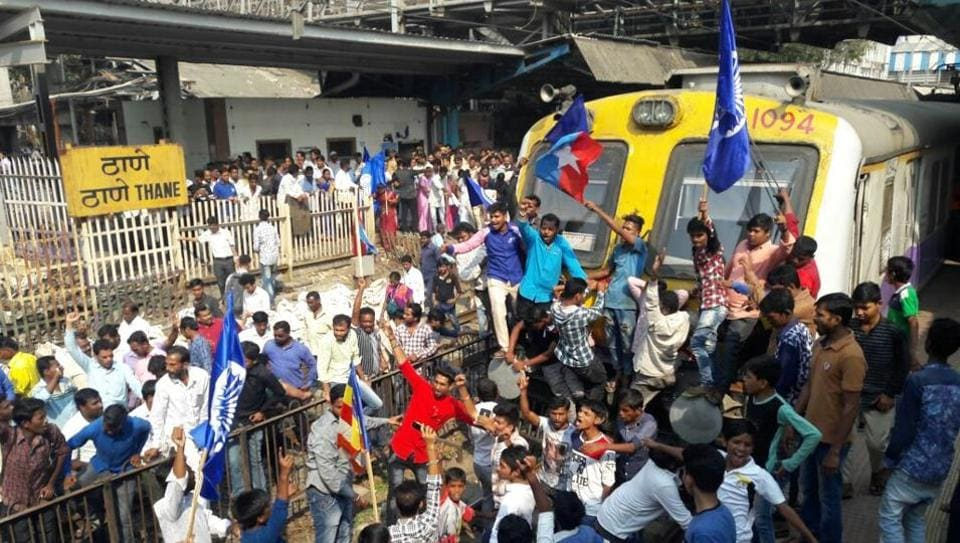 Protesters block trains at Thane railway station. Train services were badly affected in Mumbai after rail rokos on all three corridors of the Central Railway as well as on the Western Railway during a state-wide bandh called by Dalit groups on Wednesday. (Praful Gangurde / HT Photo)