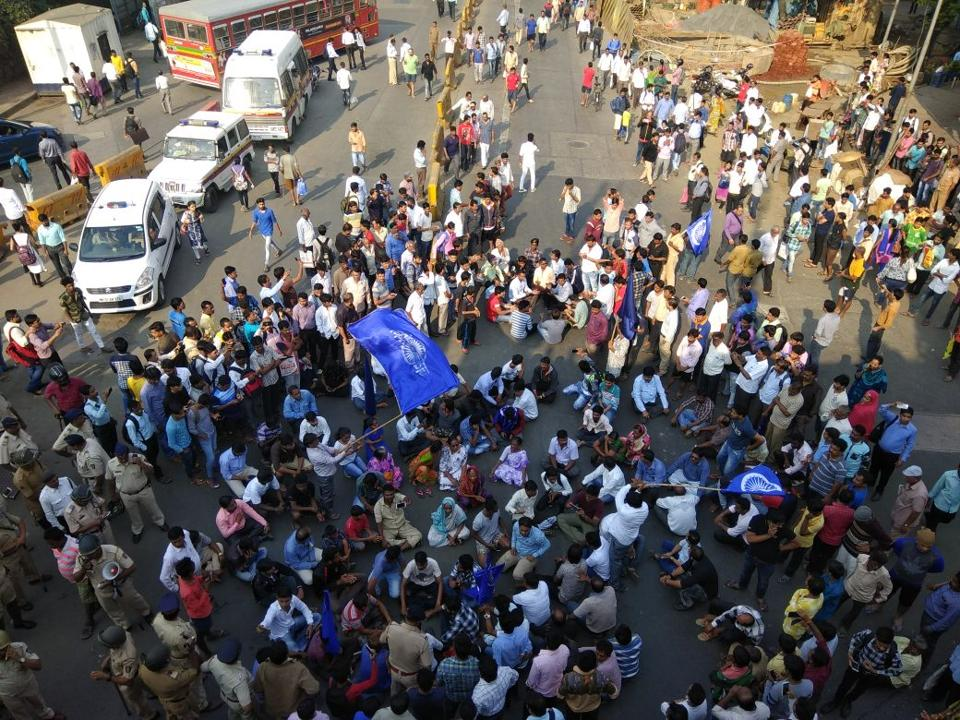 Dalit protester sit and block Akurli Road in Kandivli (East) on Wednesday morning.