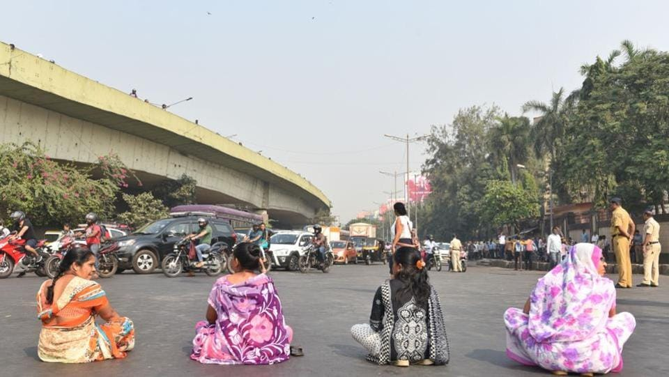Protesters block a road in Mumbai's Bandra on Wednesday. Though many taxi-auto rickshaw unions have supported the shutdown, Mumbai's lifeline, the suburban trains and the BEST (Bombay Electric Supply And Transport) bus services were plying near-normally, with delays and thin crowds. (Satyabrata Tripathy / HTPhoto)