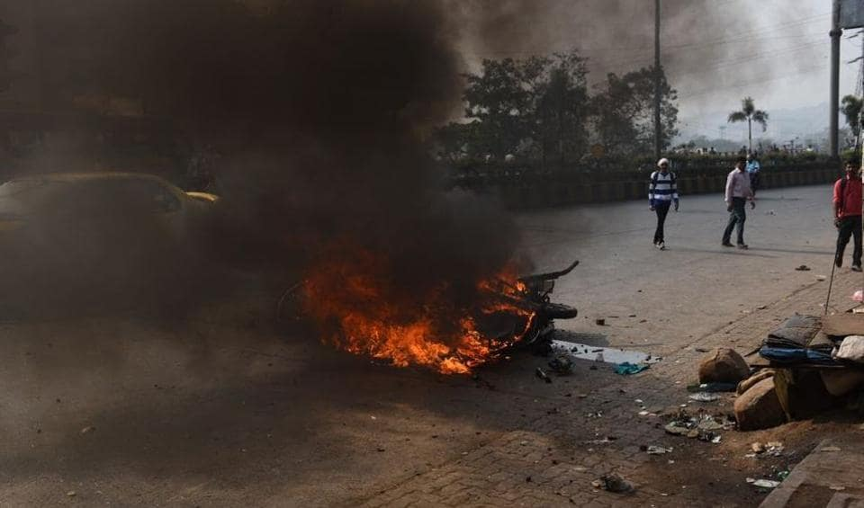 Protesters set a bike on fire in Powai on Wednesday afternoon.
