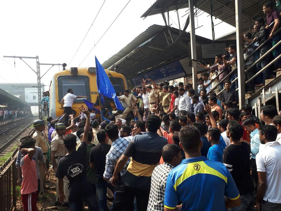 Protesters block a train on platform no. 2 on the central line at Dadar station on Wednesday.