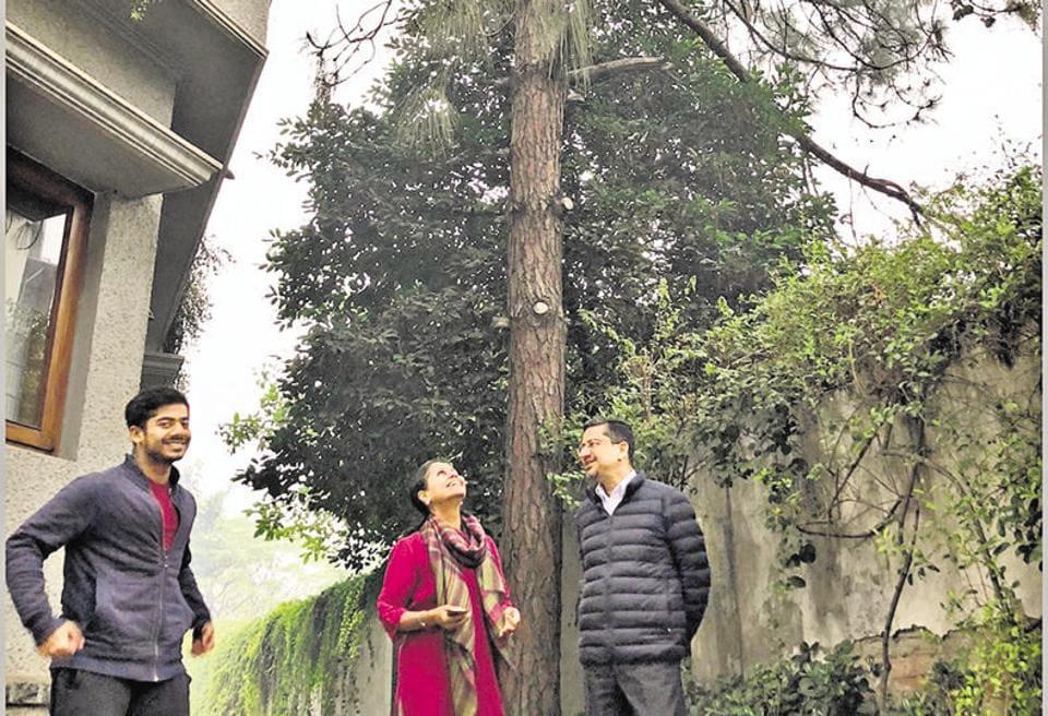 Businessman Madhav Shriram with his wife Divya and son Rohan under their beloved pine tree.