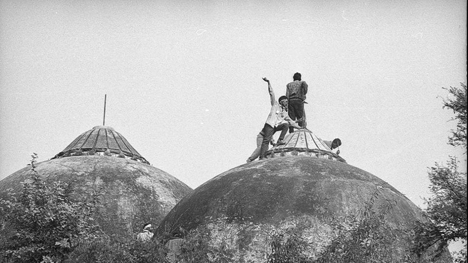 People climbing the Babri Masjid during its demolition in Ayodhya on December 6, 1992.(HT File Photo)
