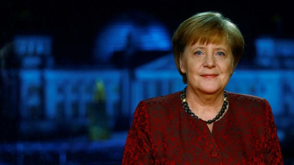 German acting Chancellor Angela Merkel poses for photographs after the television recording of her annual New Year's speech at the Chancellery in Berlin, Germany, December 30, 2017.