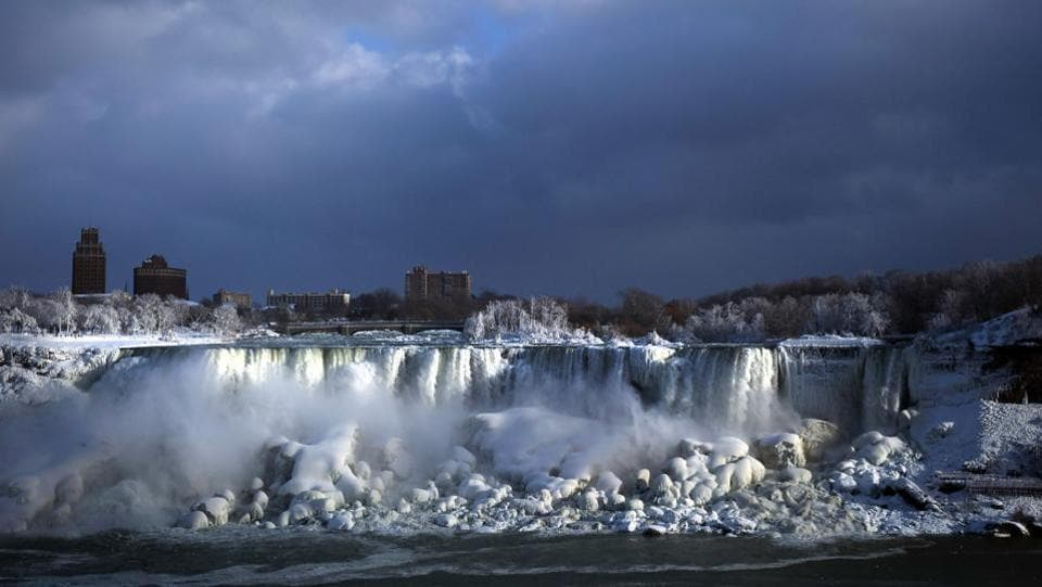 Water flows over the American Falls as ice forms in this view from the Canadian side in Niagara Falls, Ontario. Although everything around them freezes, the three waterfalls that make up the natural attraction between the United States and Canada continue to flow and churn up the frosty mist. (Aaron Lynett / The Canadian Press via AP)