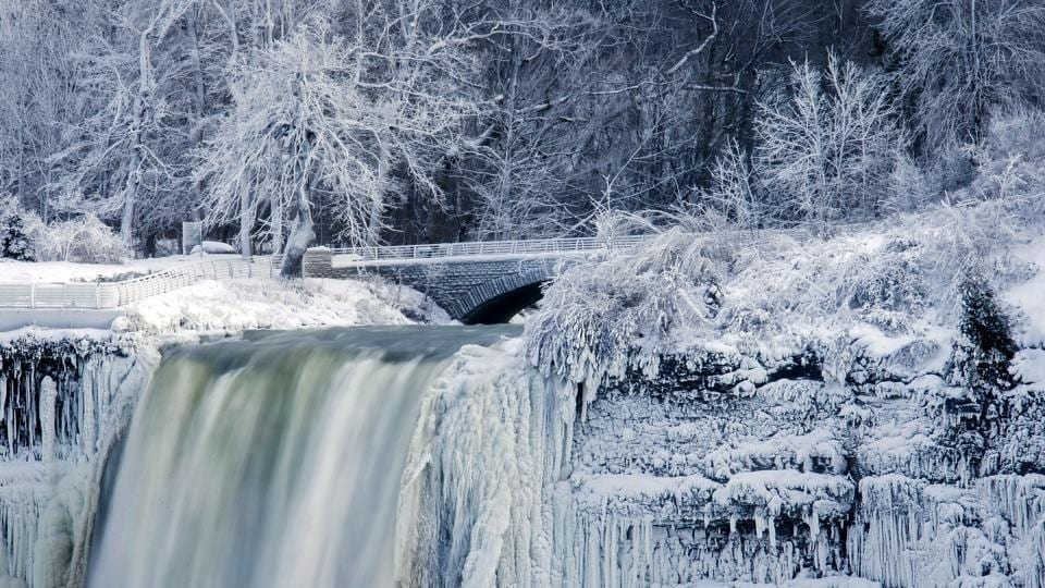 Water flows over the Bridal Veil Falls in Niagara Falls, New York with the rock faces covered in frozen mist and icicles. Such surreal scenes of freezing have been seen all the way down to Georgia where January's average high is 16 degrees. (Aaron Lynett / The Canadian Press via AP)