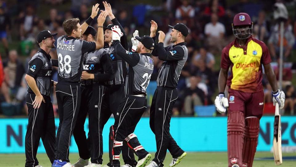 New Zealand players celebrate after the dismissal of a West Indies batsman during the third T20 international cricket match at Bay Oval in Mount Maunganui on Wednesday.  Colin Munro has scored his third T20 international century. Get highlights of NZ vs WI here.