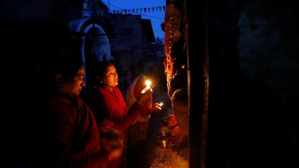As part of the rituals, unmarried women pray for a good groom while those already married pray for the longevity of their husbands by observing a month-long fast. (Navesh Chitrakar / REUTERS)