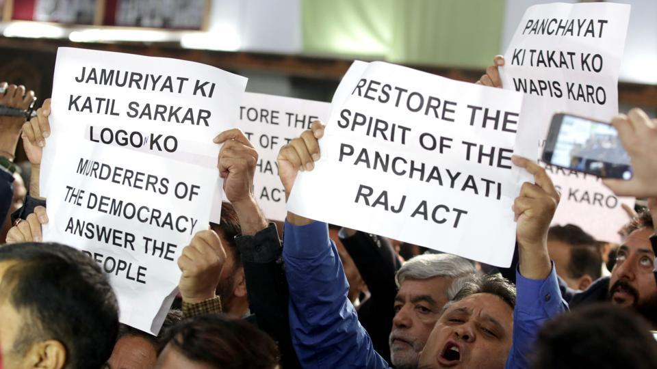 Members of the National Conference and Congress holding placards and shouting slogans against Jammu and Kashmir government as they interrupt governor NN Vohra's address during the joint session of the bicameral legislature in Jammu, on Tuesday.