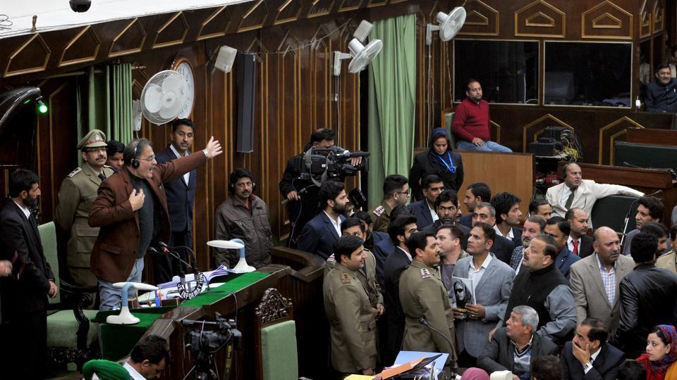 National Conference and Congress MLAs protested inside the J&K Legislative assembly and staged a walkout in the middle of the governor's address during the budget session in Jammu on Wednesday. ( Nitin Kanotra / HT Photo)