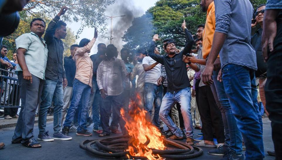 People protest following the Bhima Koregaon violence, which resulted in road blockades and vandalised city buses near Pune Station on January 2, 2018.