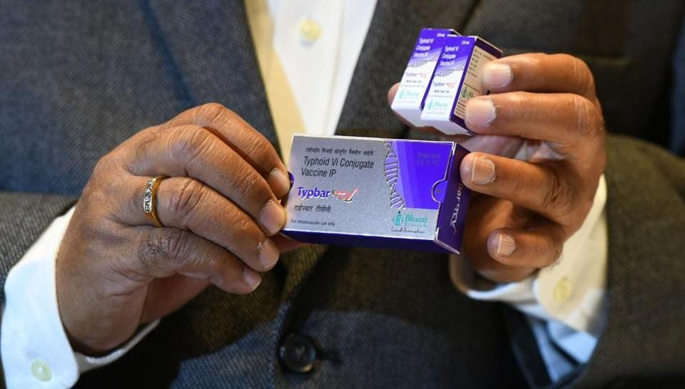 Krishna Ella, chairman and managing director of Bharat Biotech, holds a package of the typhoid vaccine Typbar-TCV during a press conference in Hyderabad.