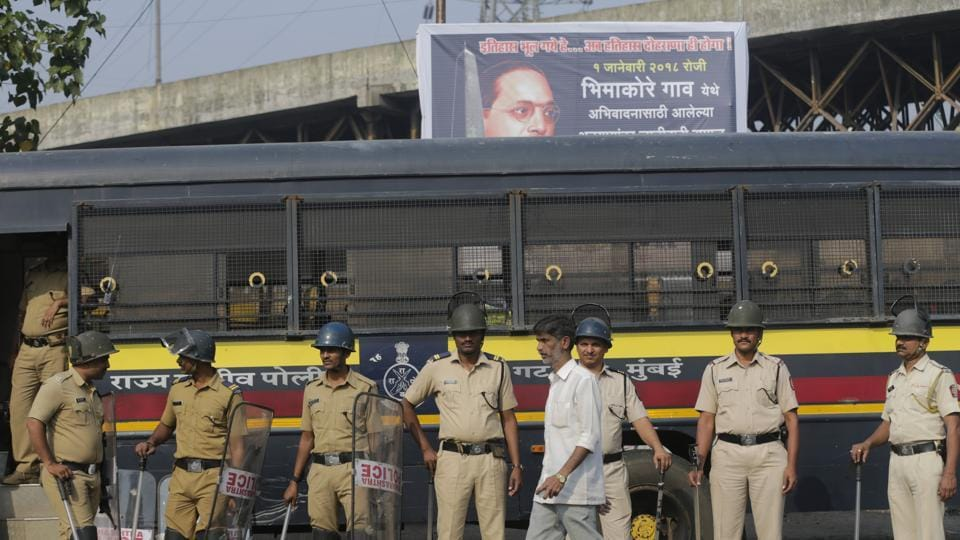 Policemen stand guard during a strike called by Dalit groups in Mumbai on January 3, 2018. A statewide strike was called by several Dalit groups on Wednesday following the death of a 28-year-old Dalit in Pune district.