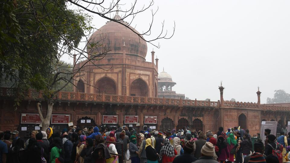 Visitors gather at the ticket office of the Taj Mahal in Agra on January 3, 2018. The Archaeological Survey of India is likely to restrict the number of tourists visiting the Taj Mahal to 40,000 daily, and put a three-hour cap on each ticket holder, in a bid to preserve the heritage site. (Dominique Faget / AFP)