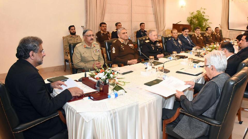 A handout picture taken and released by the Pakistan Press Information Department (PID) on January 2, 2018, shows Pakistani Prime Minister Shahid Khaqan Abbasi (L) addressing the National Security Council meeting in Islamabad.