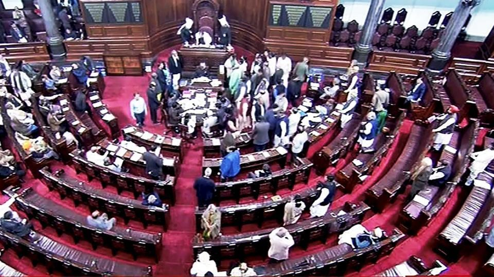 Opposition members protest inside the Rajya Sabha during the ongoing winter session of Parliament. (PTI Photo / TV Grab)