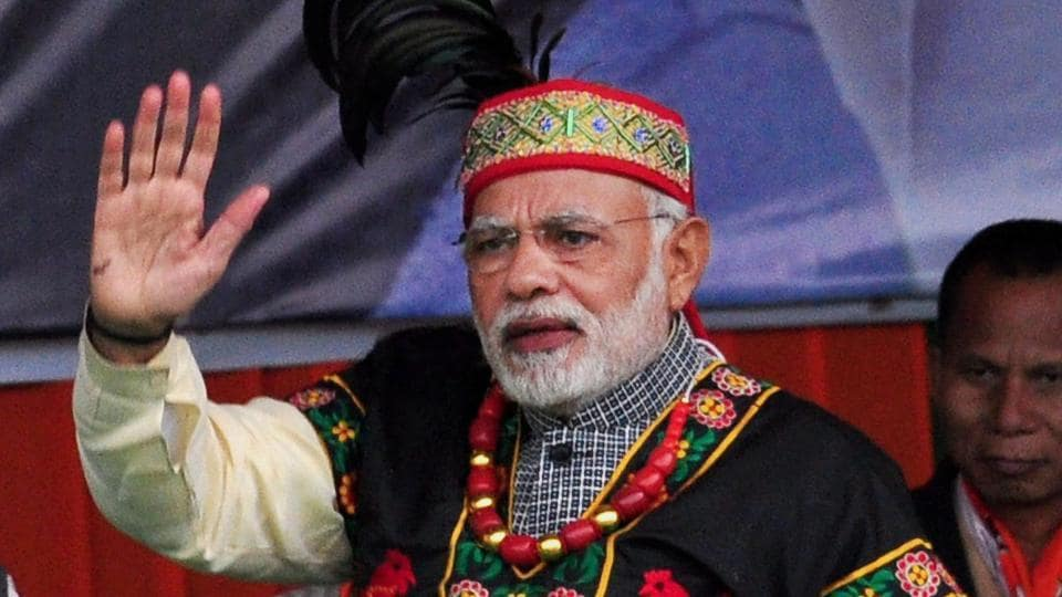 Prime Minister Narendra Modi greets a gathering during 'Rally for Change' at Jawaharlal Nehru Stadium, in Shillong on Saturday.