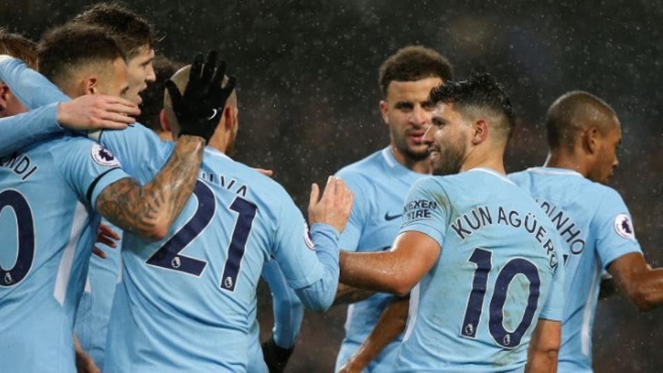 Manchester City's Sergio Aguero celebrates scoring their third goal vs Watford at the Eastlands with teammates.