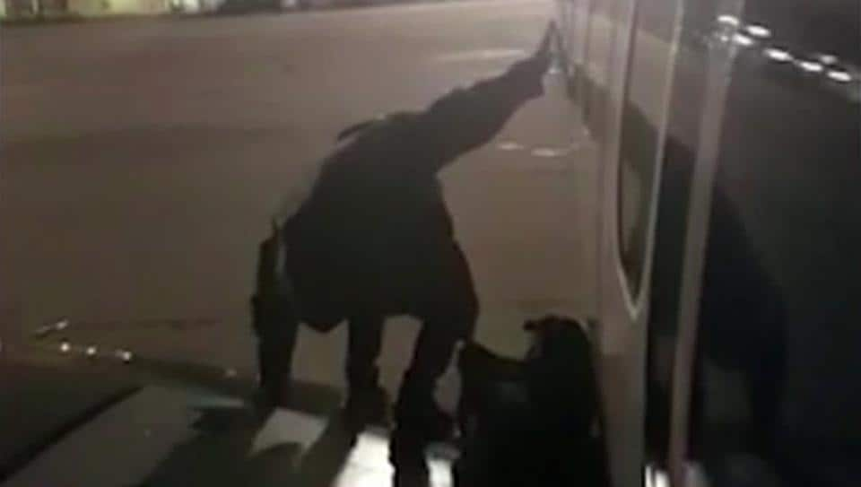 A Ryanair passenger who apparently got fed up waiting to get off the plane stands on the wing of a Ryanair plane at Malaga airport, Spain, Monday Jan. 1, 2018, filmed by another passenger.