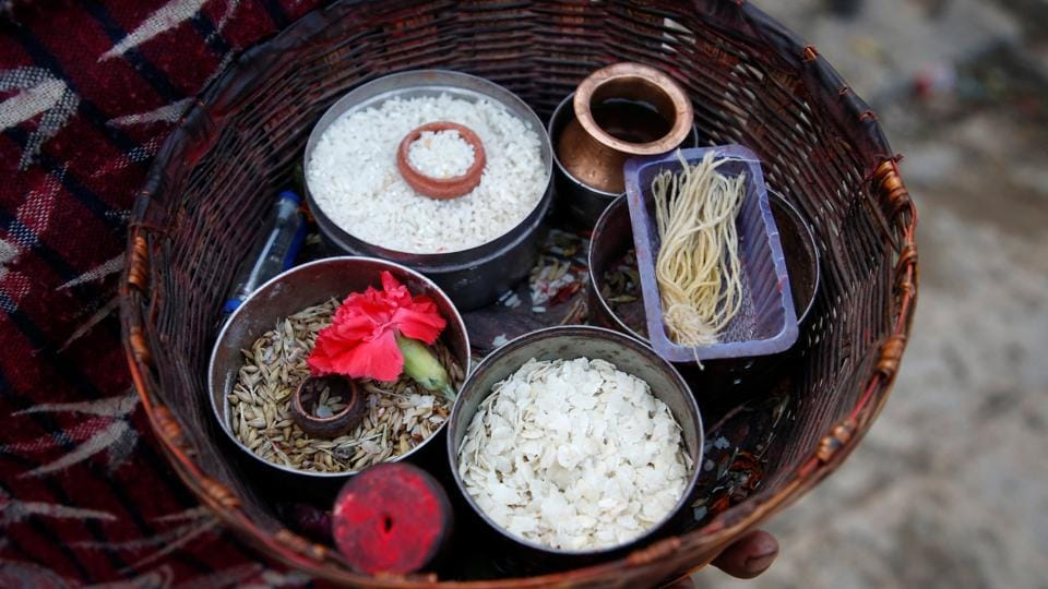 A basket holds offerings of grains used during the festival. The 30-day fast called 'brata' in the local Newari and Nepali languages  is voluntary and some men also undertake it seeking the welfare of their families. (Navesh Chitrakar / REUTERS)