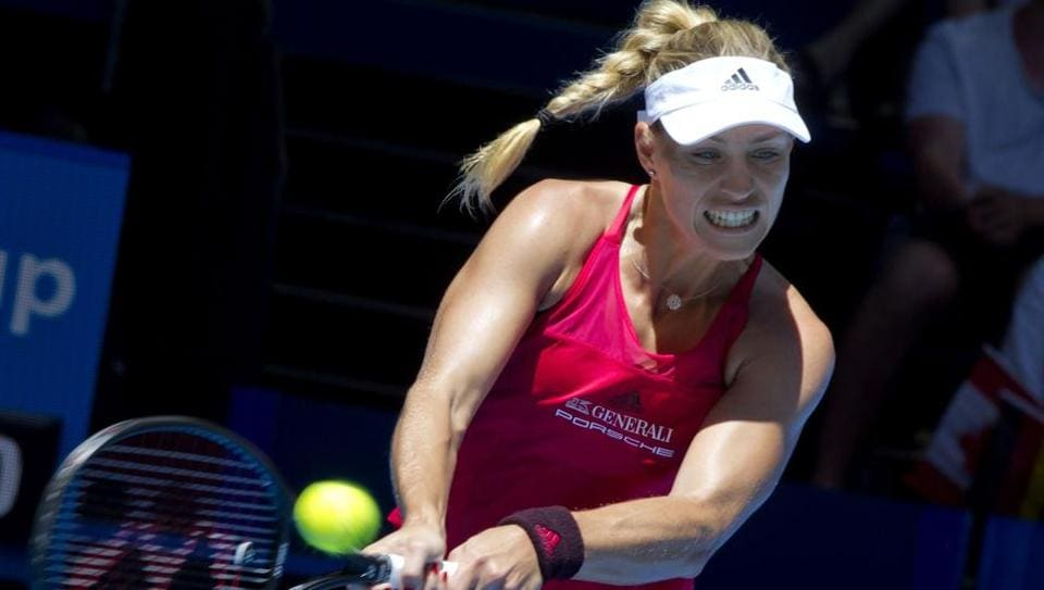 Angelique Kerber returns against Eugenie Bouchard during their seventh session women's singles match on day five of the Hopman Cup tennis tournament in Perth on January 3, 2018.