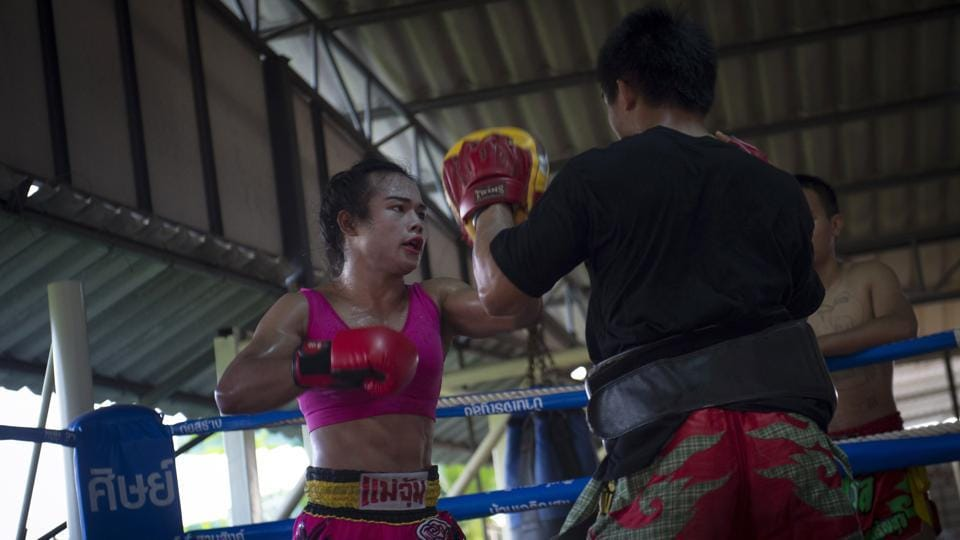 "In life as in the ring, where she competes against men, finding her place has not always been easy. Transgender people in Thailand still can't change their gender designation on identity papers, despite a 2015 law against gender-based discrimination. ""When I started fighting (as a girl), I was afraid that people would not accept me,"" she said.  (Lilian Suwanrumpha / AFP)"