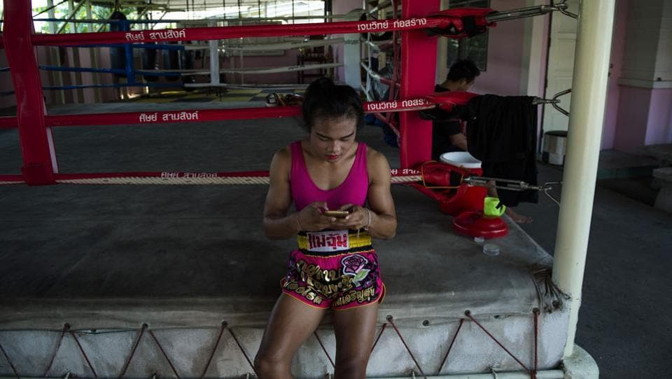 "Lacking legal recognition, challenges exist when navigating medical care or bureaucratic processes. But the ring is a different story. ""In combat, she always walks on you and hammers you with her knees,"" said Chalongchai Meemindee, a 25-year-old boxer who faced her in November. ""It's good to have her in the ring because it brings colour and attracts viewers, especially foreigners,"" he added. (Lilian Suwanrumpha / AFP)"
