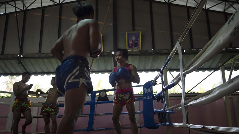 "Rose spars with a fellow boxer in Chachoengsao. She recalls her male opponents being initially rattled -- or even angered -- by her appearance. ""In my village everyone knew me so it was easy,"" she says. ""But outside the city, some boxers looked at me wrong and said that trans people could not win."" (Lilian Suwanrumpha / AFP)"