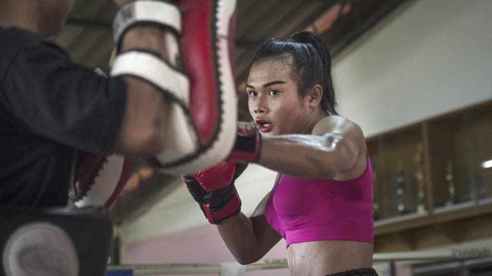 Stepping into the ring clad in a pink tank top and red lipstick, Nong Rose does pad work in a Thai boxing gym, preparing for a foreign debut that will make her the first transgender fighter to enter the ring in France. Ahead of the Muay Thai match in Paris, the 21-year-old is training hard in central Thailand's Chachoengsao province, with her brother as sparring partner. (Lilian Suwanrumpha / AFP)