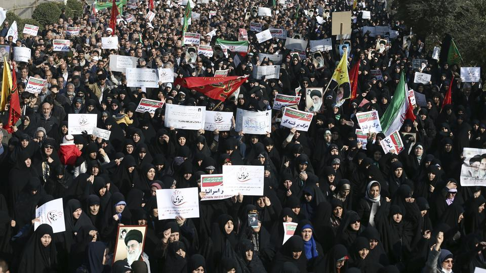 A December 30, 2017, photo of Iranian protesters chanting slogans at a rally in Tehran.
