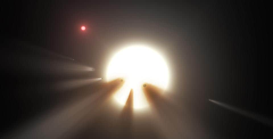 NASA image obtained January 3, 2018 shows an illustration of a star behind a shattered comet. Observations of the star KIC 8462852 by NASA's Kepler and Spitzer space telescopes suggest that its unusual light signals are likely from comet fragments.