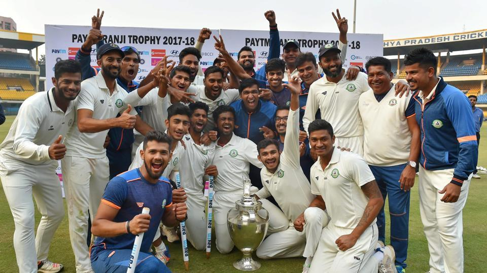 Vidarbha players celebrate with the trophy after winning the Ranji Trophy final against Delhi by 9 wickets in Indore on Monday.