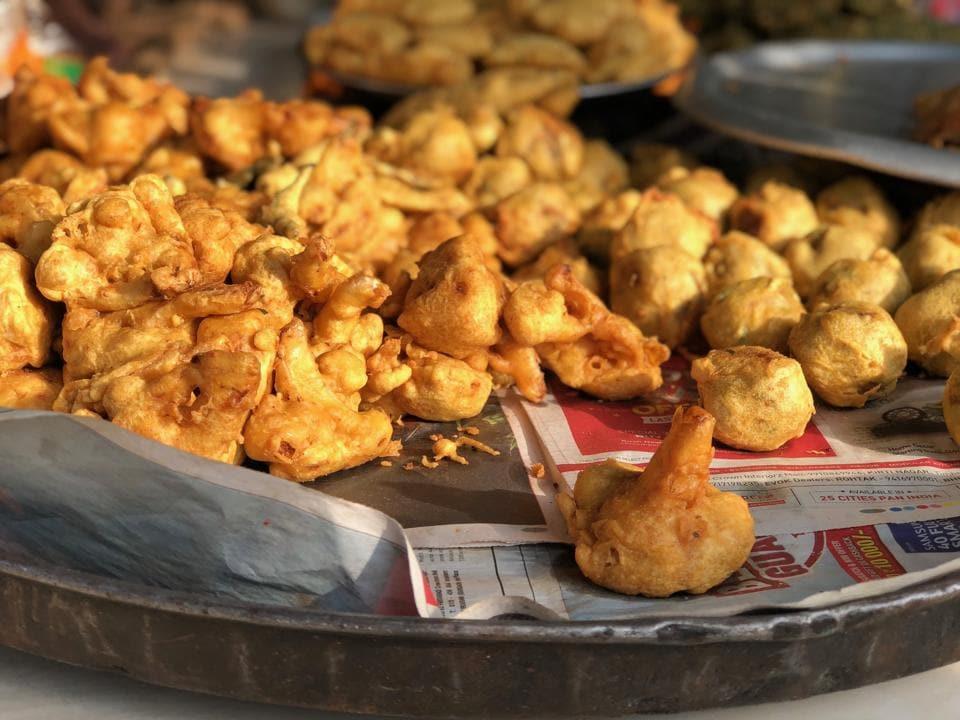 Gyan fried gigantic pakoras in a giant cauldron at his tin shop in Jangpura Extension.