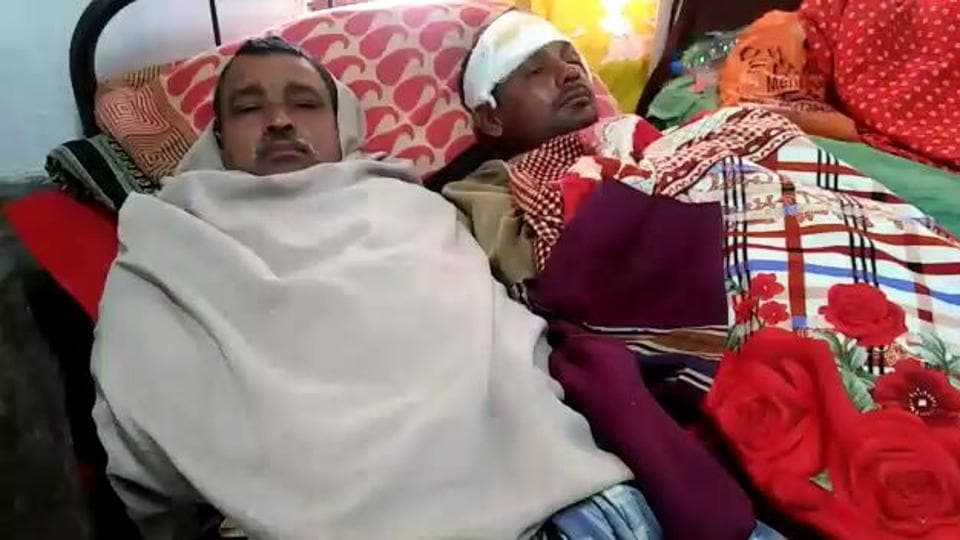Two of the injured in Malda Medical College and Hospital on Wednesday.