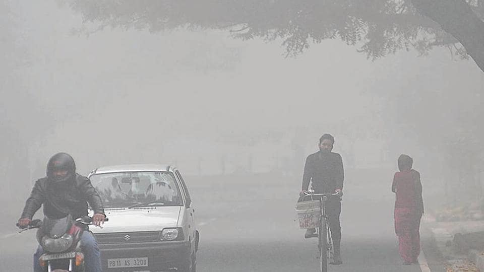 Commuters making their way through a think blanket of fog in Sector 34, Chandigarh, on Wednesday. Moderate to dense fog will continue for three days, said the weatherman.