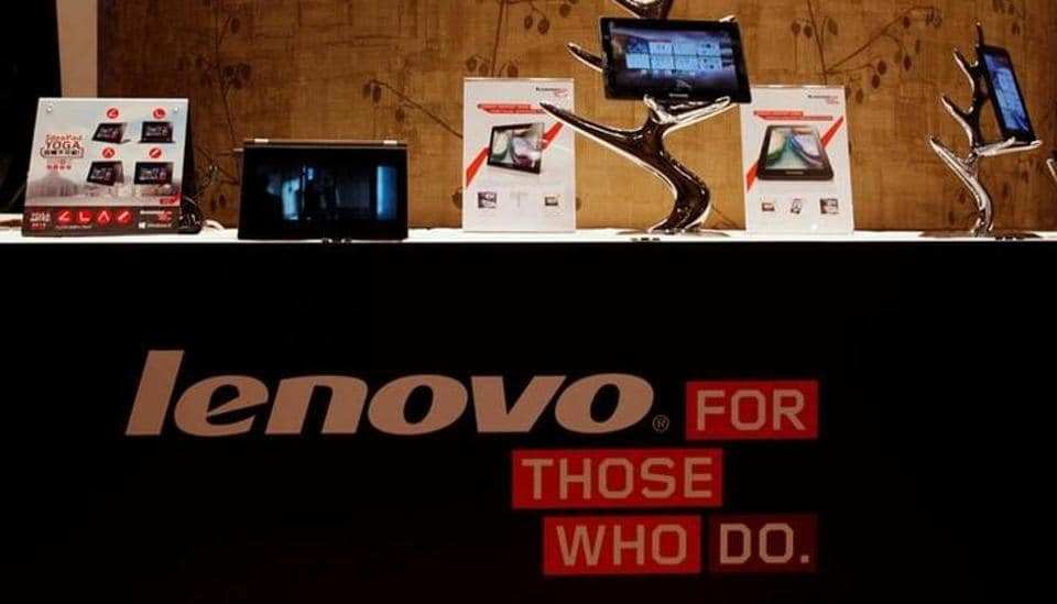Lenovo tablets and mobile phones are displayed during a news conference on the company's annual results in Hong Kong May 23, 2013.