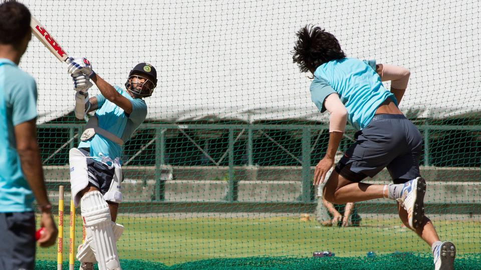 Indian cricket team's Ishant Sharma bowls to Shikhar Dhawan (left)  during a nets session ahead of the first Test against South Africa cricket team at Newlands Stadium in Cape Town.