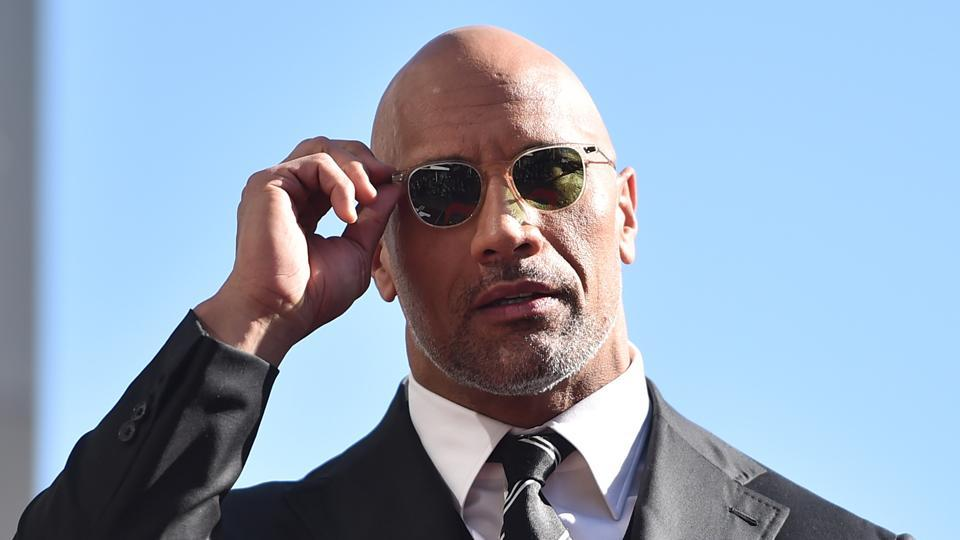 Actor Dwayne Johnson attends a ceremony honouring him with the 2,624th star on the Hollywood Walk of Fame on December 13, 2017 in Hollywood.