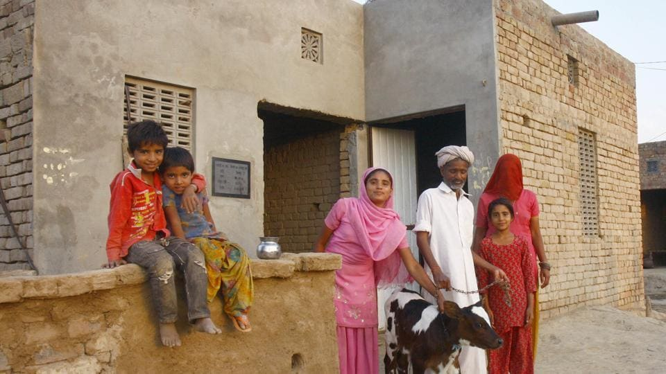 A BPL family in Rajasthan  outside their house.