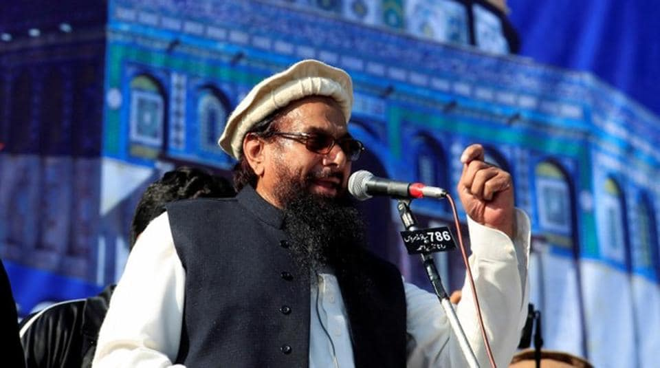 Hafiz Muhammad Saeed (C), chief of the Islamic charity organisation Jamaat-ud-Dawa (JuD), speaks to supporters during a gathering to protest against Trump's decision to recognise Jerusalem as the capital of Israel, in Rawalpindi, Pakistan December 29, 2017.
