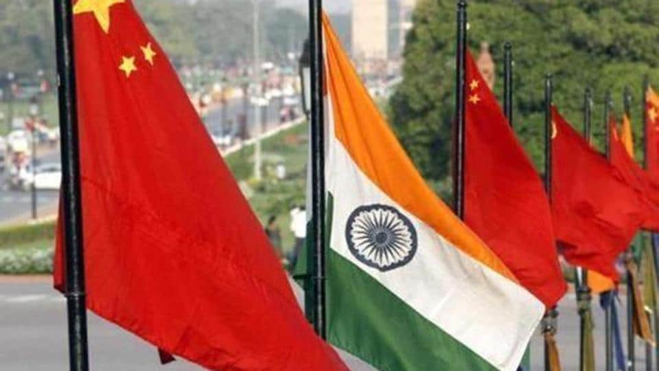 National flags of China and India at Vijay Chowk on Rajpath in New Delhi.