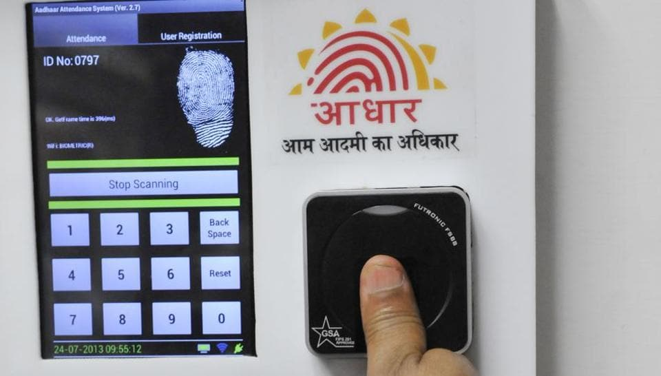 Employees mark their attendance through Aadhaar in the Planning Commission in New Delhi.