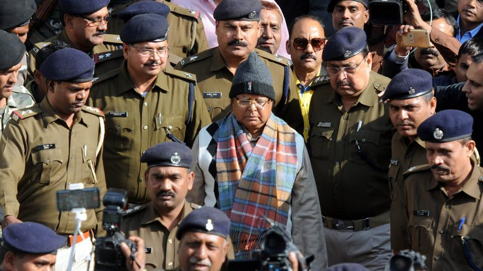 Convicted former chief minister of Bihar Lalu Prasad under heavy security arrives at a special CBI court in Ranchi, on Thursday.