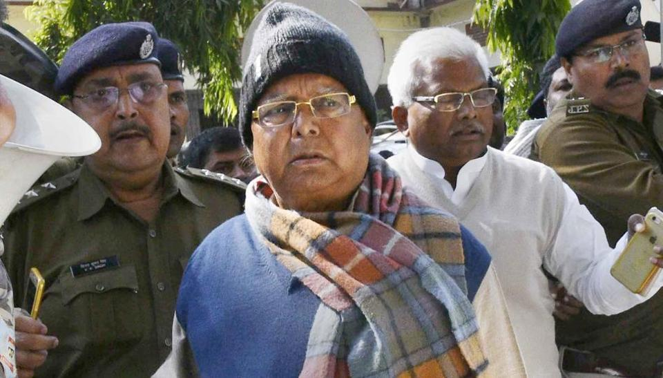 Bihar's former chief minister Lalu Yadav escorted by police officials after appearing at the special CBI court, in Ranchi on Wednesday.