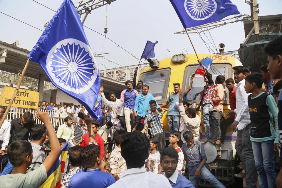 Dalit groups protesting at Thane railway station during the Maharashtra Bandh on Wednesday following clashes between two groups in Bhima Koregaon near Pune, in Mumbai.