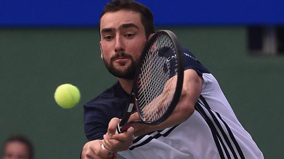 Marin Cilic plays a shot against French tennis player Pierre-Hugues Herbert during the Tata Open tennis tournament.