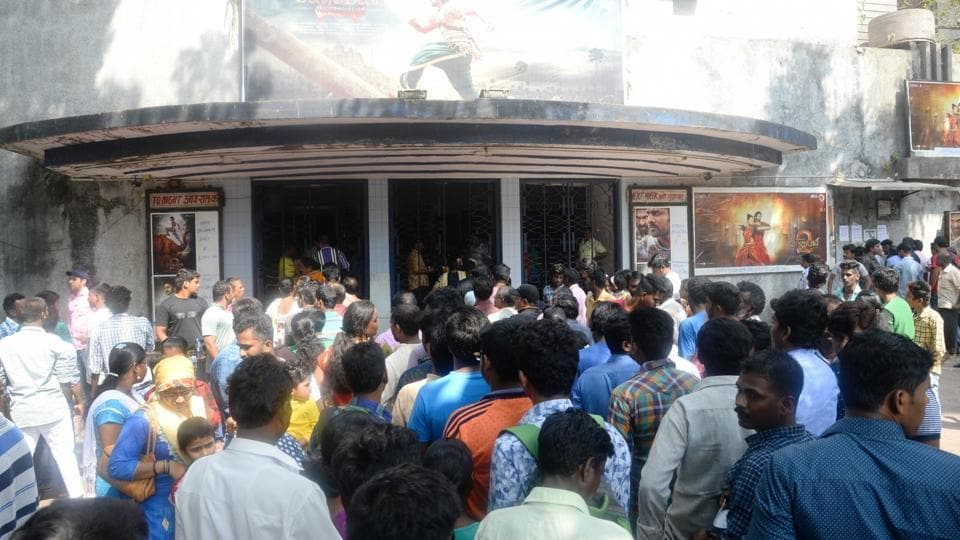 People throng a cinema hall to watch