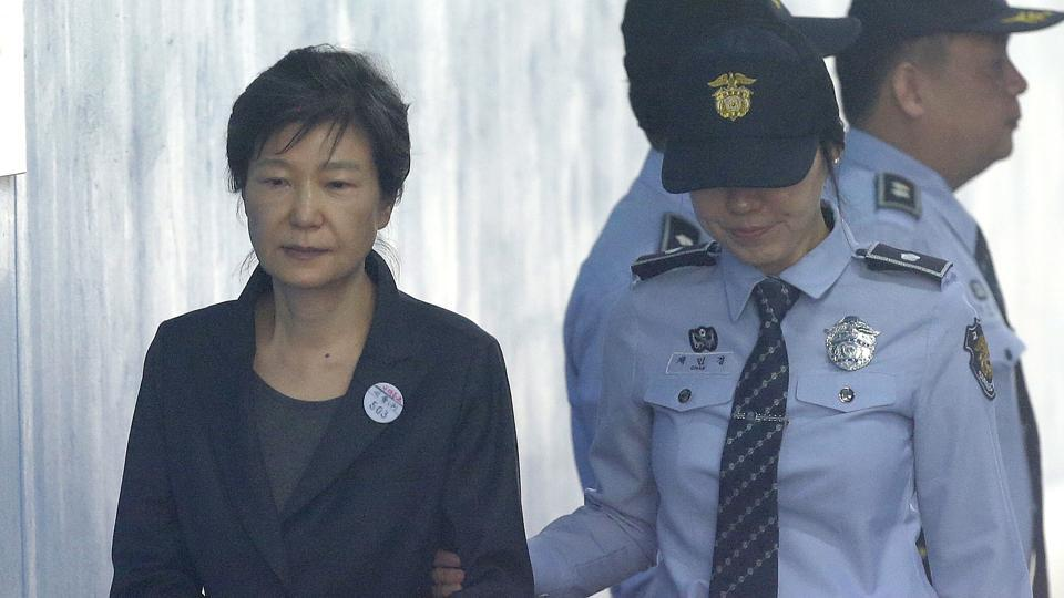 Former South Korean president Park Geun-hye (left) arrives to attend a hearing on the extension of her detention at the Seoul Central District Court in Seoul, South Korea.